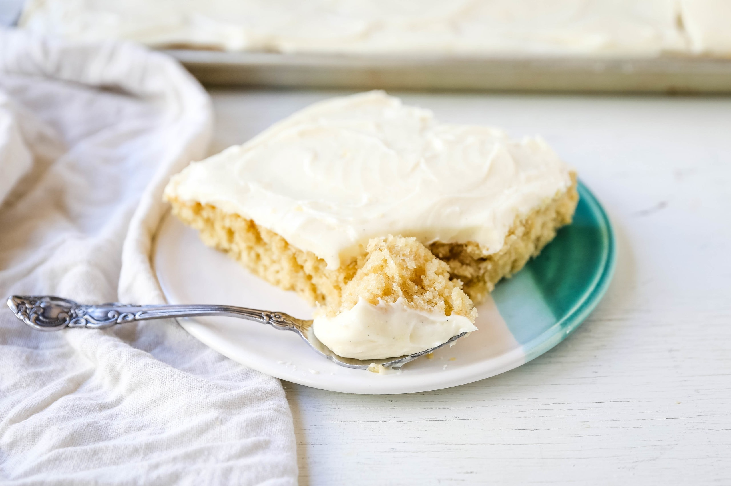Banana Sheet Cake with Brown Butter Frosting Moist banana bars with a brown butter cream cheese buttercream. An easy frosted banana cake recipe! www.modernhoney.com #bananacake #bananabars #frostedbananacake #frostedbananabars #bananarecipes