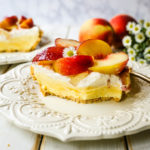 Peaches and Cream Pie. A quick and easy no-bake creamy peach pie with a buttery graham cracker crust, a sweet custard filling, fresh whipped cream, and sliced peaches.  www.modernhoney.com #pie #nobakedessert #nobakepie #peachdessert #peaches #peach