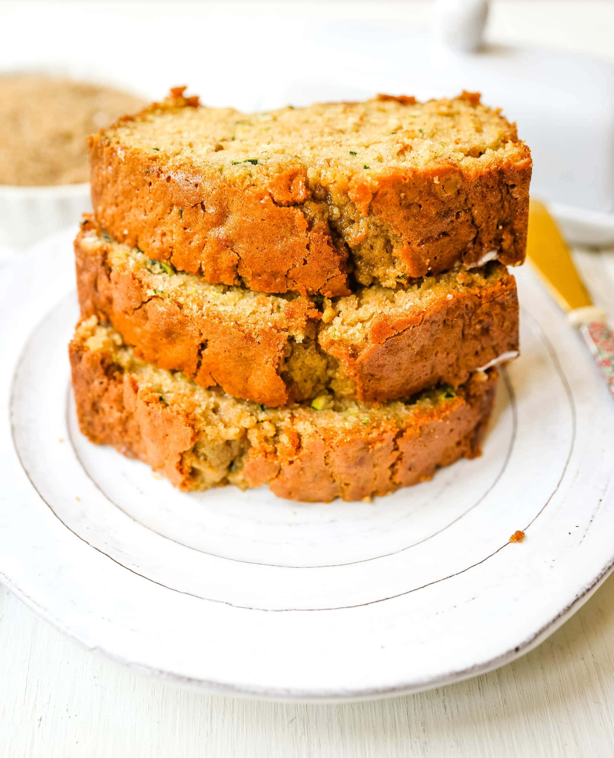 Zucchini Bread. This moist, sweet zucchini bread with a touch of spice is the best zucchini bread recipe out there!  www.modernhoney.com #zucchinibread #zucchini #quickbread #bread