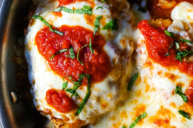 Chicken Parmesan. Panko-crusted chicken breast topped with homemade marinara sauce, melted whole milk mozzarella, and parmesan cheeses and baked until golden and bubbly.www.modernhoney.com #chicken #chickenparmesan #italian