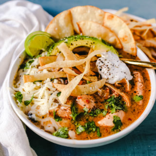 Slow Cooker Creamy Chicken Tortilla Soup Creamy, spicy, warm, and comforting creamy chicken tortilla soup all made in a crockpot! The best crockpot creamy chicken tortilla soup recipe! www.modernhoney.com #soup #chickentortillasoup #mexicanfood
