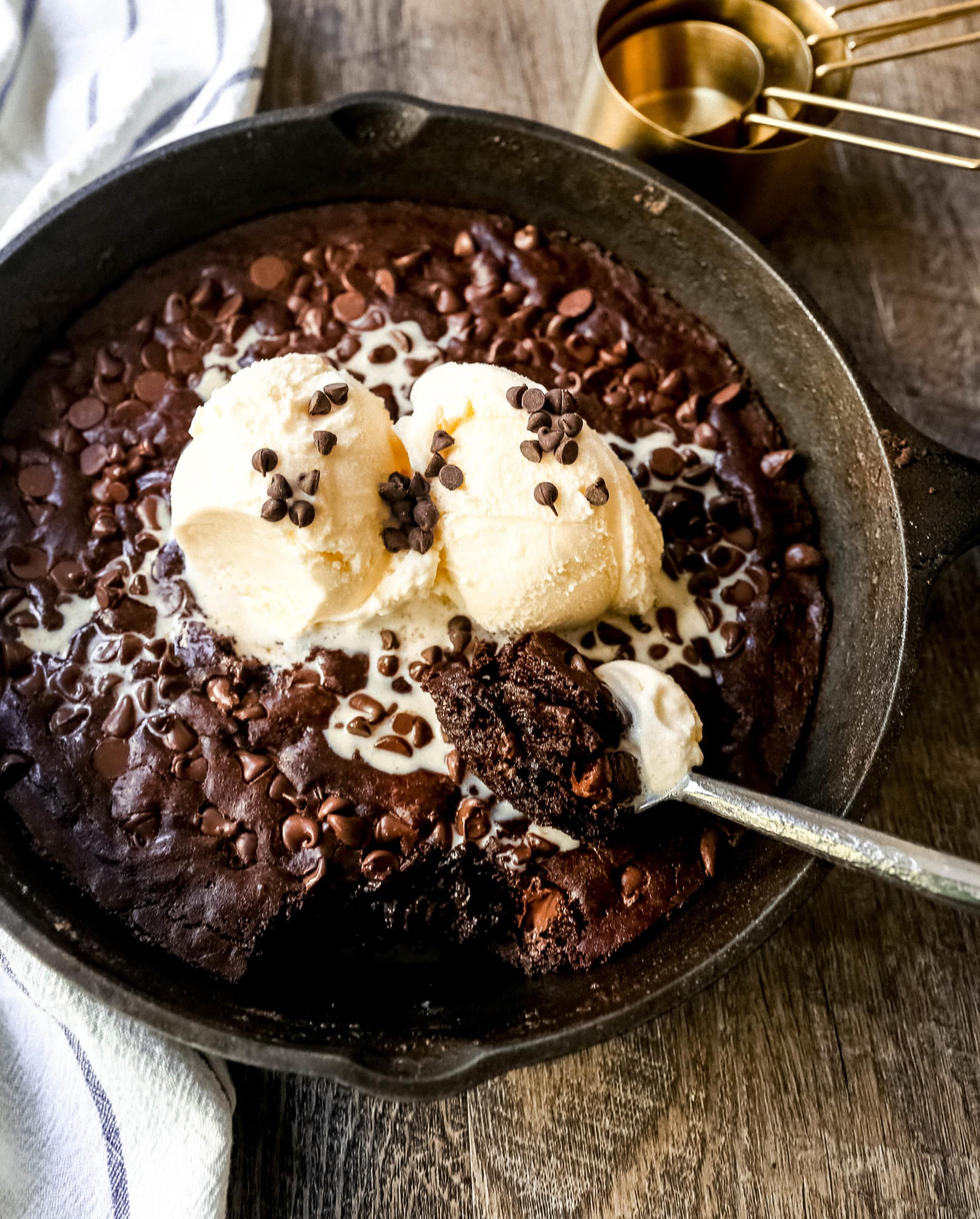 Double Chocolate Chocolate Chip Skillet Cookie Rich, chewy double chocolate chip cookie baked in a cast-iron skillet and topped with ice cream. www.modernhoney.com #doublechocolatechipskilletcookie #skilletcookie