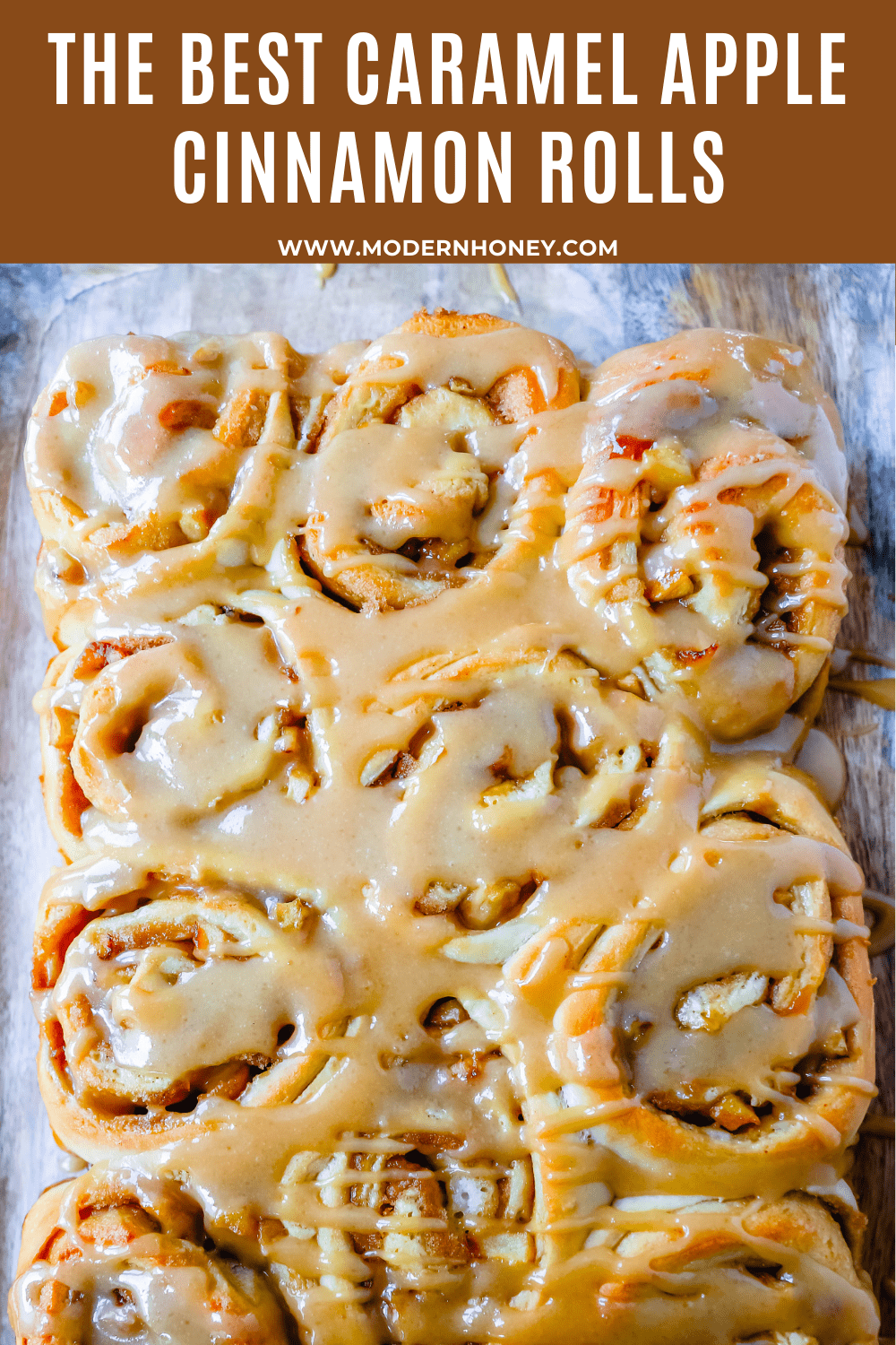 Caramel Apple Cinnamon Rolls Homemade salted caramel paired with tart apples all rolled into and baked in a sweet dough. These Salted Caramel Apple Cinnamon Rolls will knock your socks off! www.modernhoney.com #cinnamonrolls #caramelrolls #caramelapplerolls