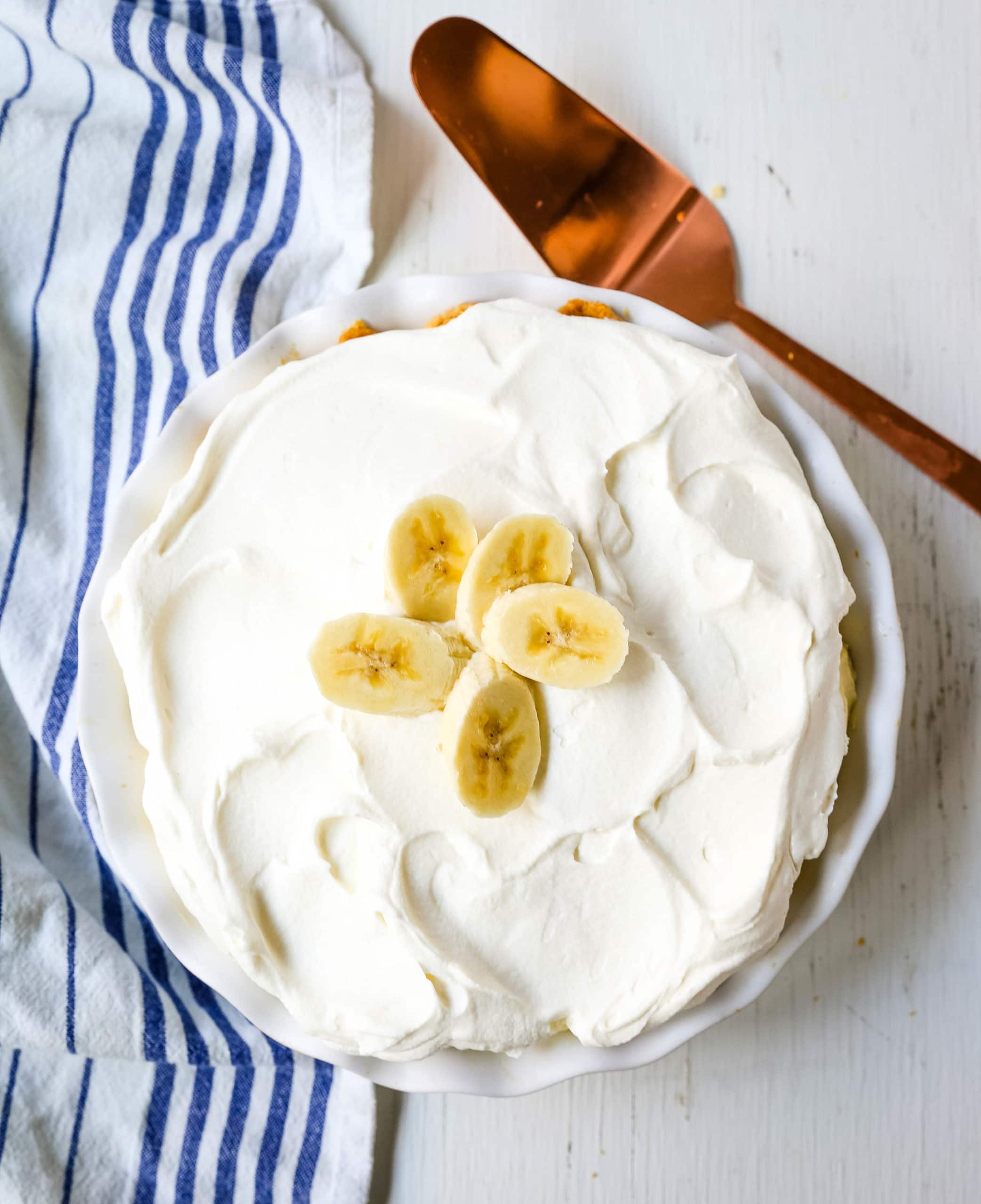 Banana Cream Pie Homemade banana cream pie made with a creamy sweet vanilla filling with fresh bananas, handcrafted whipped cream, all in a buttery pie crust. www.modernhoney.com #pie #bananacreampie #thanksgiving