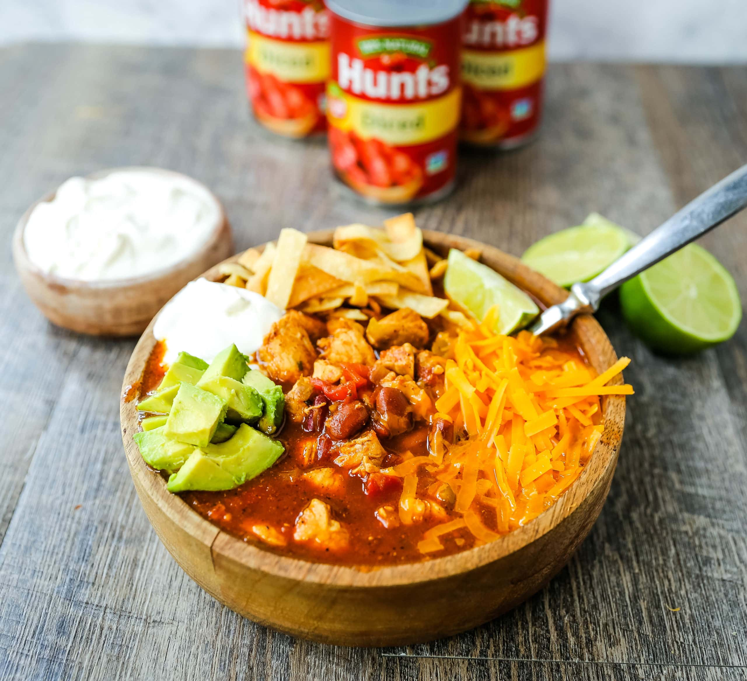 Chicken Chili. Traditional, homemade chicken chili with Mexican spices, green chilies, tomatoes, chili beans, and two secret ingredients to put it over the top! www.modernhoney.com #chili #chickenchili