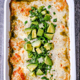 Creamy Green Chile Chicken Enchiladas Creamy chicken enchiladas stuffed with a cream cheese and sour cream green chile chicken rolled into corn tortillas and topped with green enchilada sauce and pepper jack cheese. The best creamy chicken enchiladas recipe! www.moderrnhoney.com #enchiladas #mexicanfood