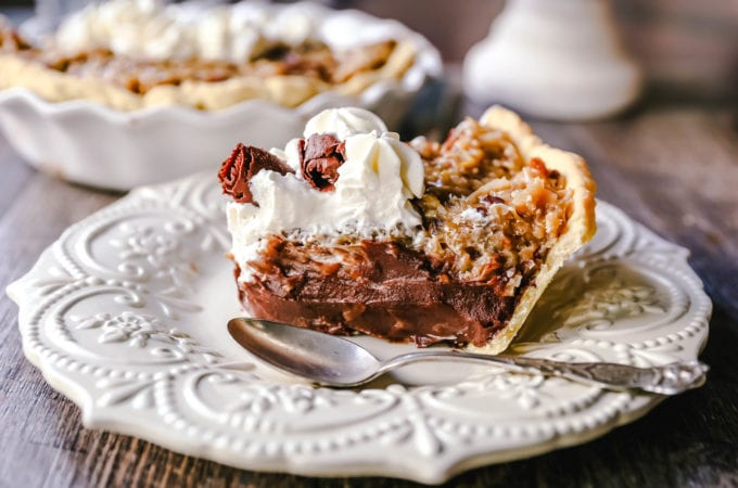 German Chocolate Pie. Creamy rich chocolate pie with a sticky German chocolate coconut-pecan topping and fresh whipped cream and chocolate shavings. www.modernhoney.com #pie #chocolatepie #germanchocolate