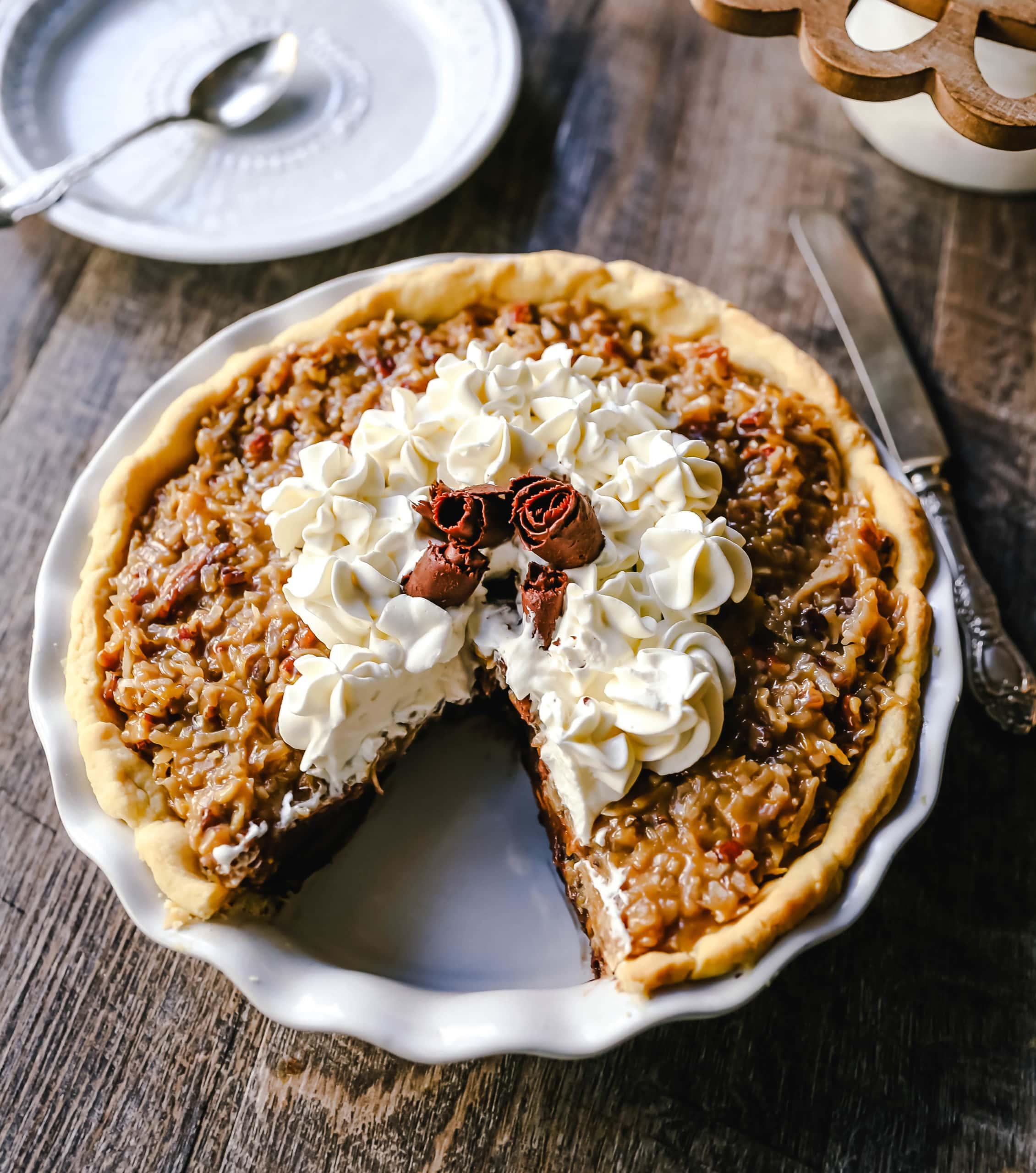 German Chocolate Pie. Creamy rich chocolate pie with a sticky German chocolate coconut-pecan topping and fresh whipped cream and chocolate shavings.www.modernhoney.com #pie #chocolatepie #germanchocolate