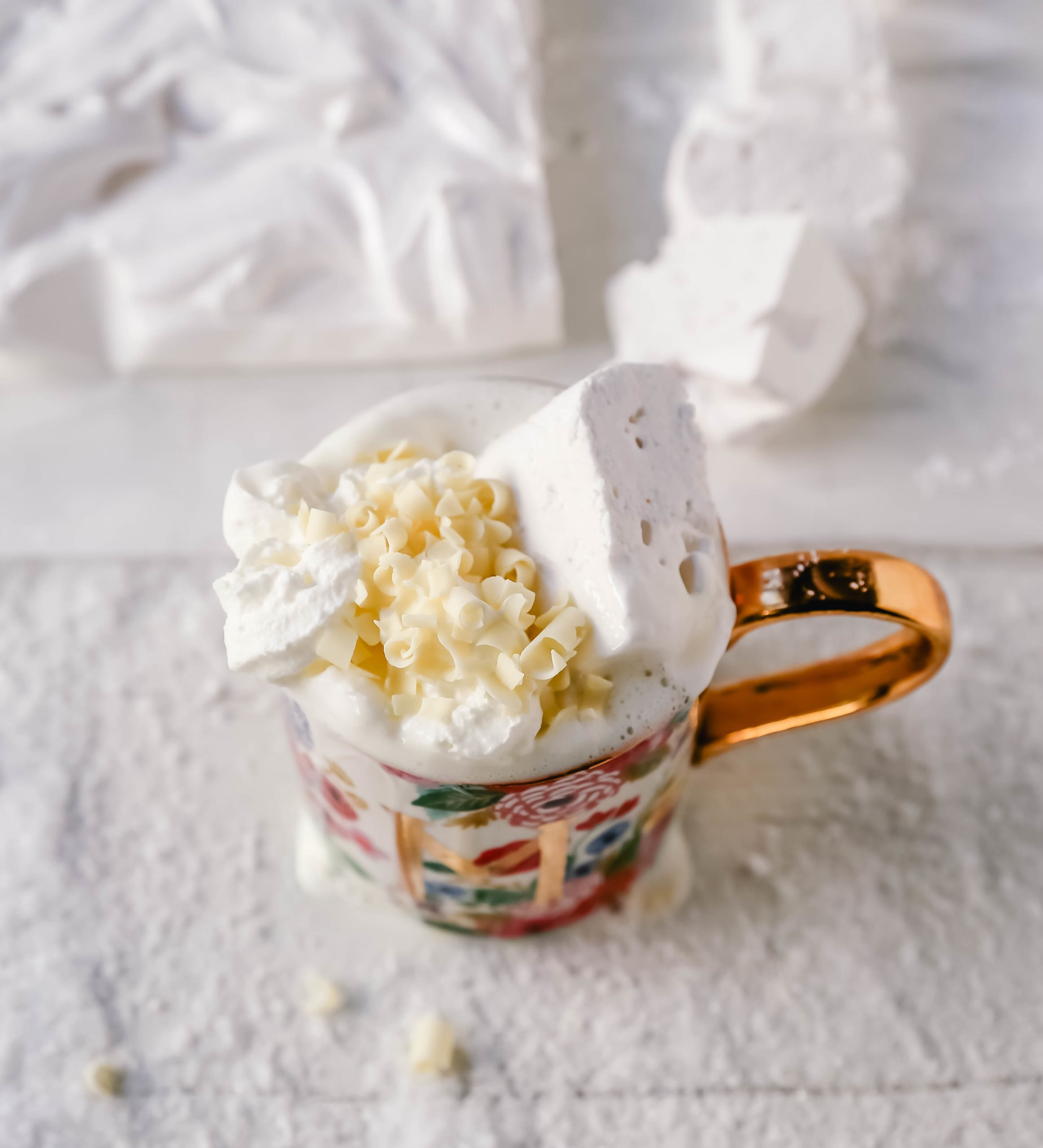 Homemade White Hot Chocolate Creamy, silky-smooth white chocolate made with white chocolate, whole milk, and vanilla beans. Topped with fresh whipped cream, homemade soft marshmallows, and white chocolate shavings. www.modernhoney.com #whitechocolate #hotwhitechocolate #whitehotchocolate
