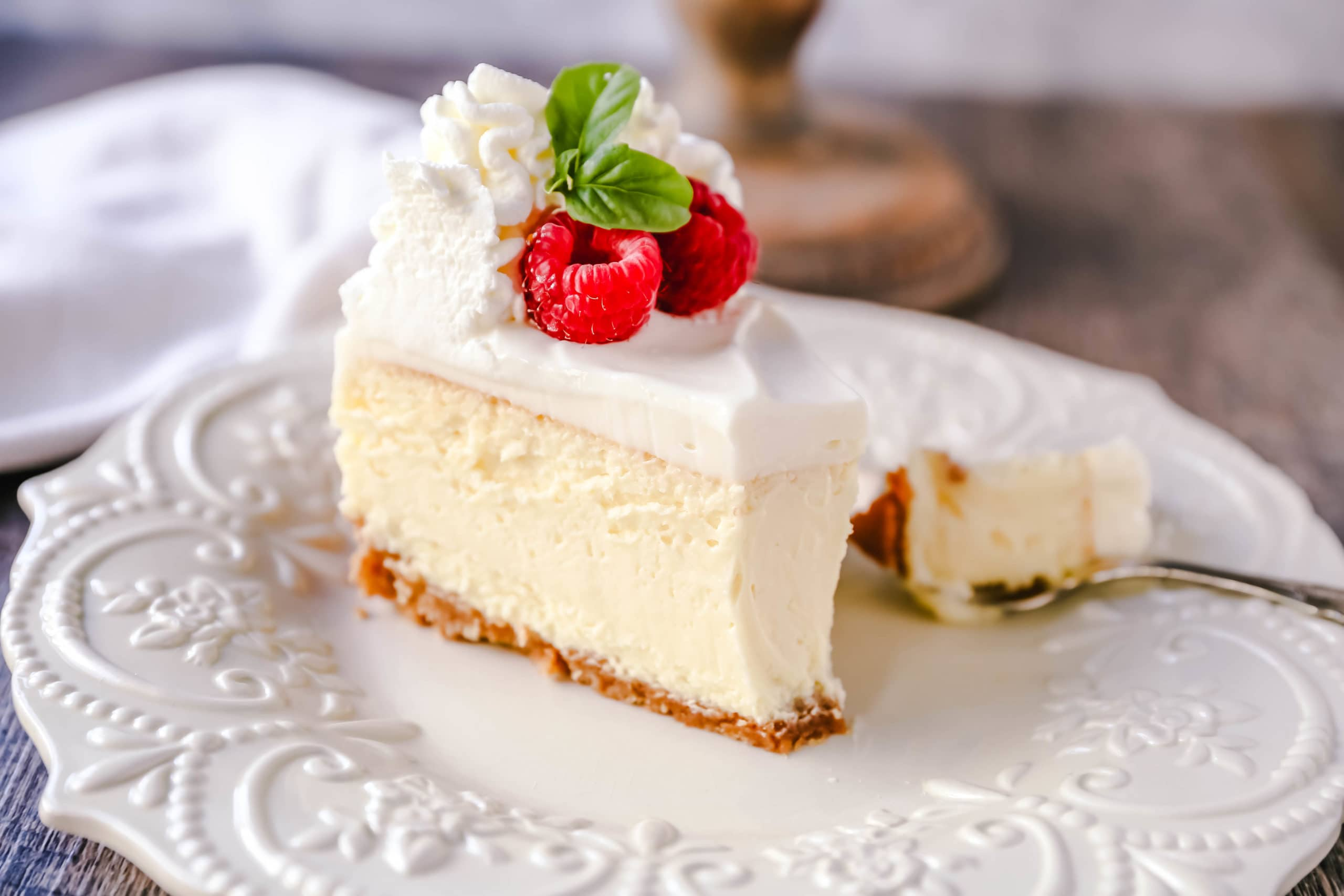 The Best Cheesecake Recipe How to make the creamiest, dreamiest, richest vanilla cheesecake with a buttery graham cracker crust. All of the tips and tricks for making the perfect cheesecake! www.modernhoney.com #cheesecake #vanillacheesecake #cheesecakerecipe #dessert
