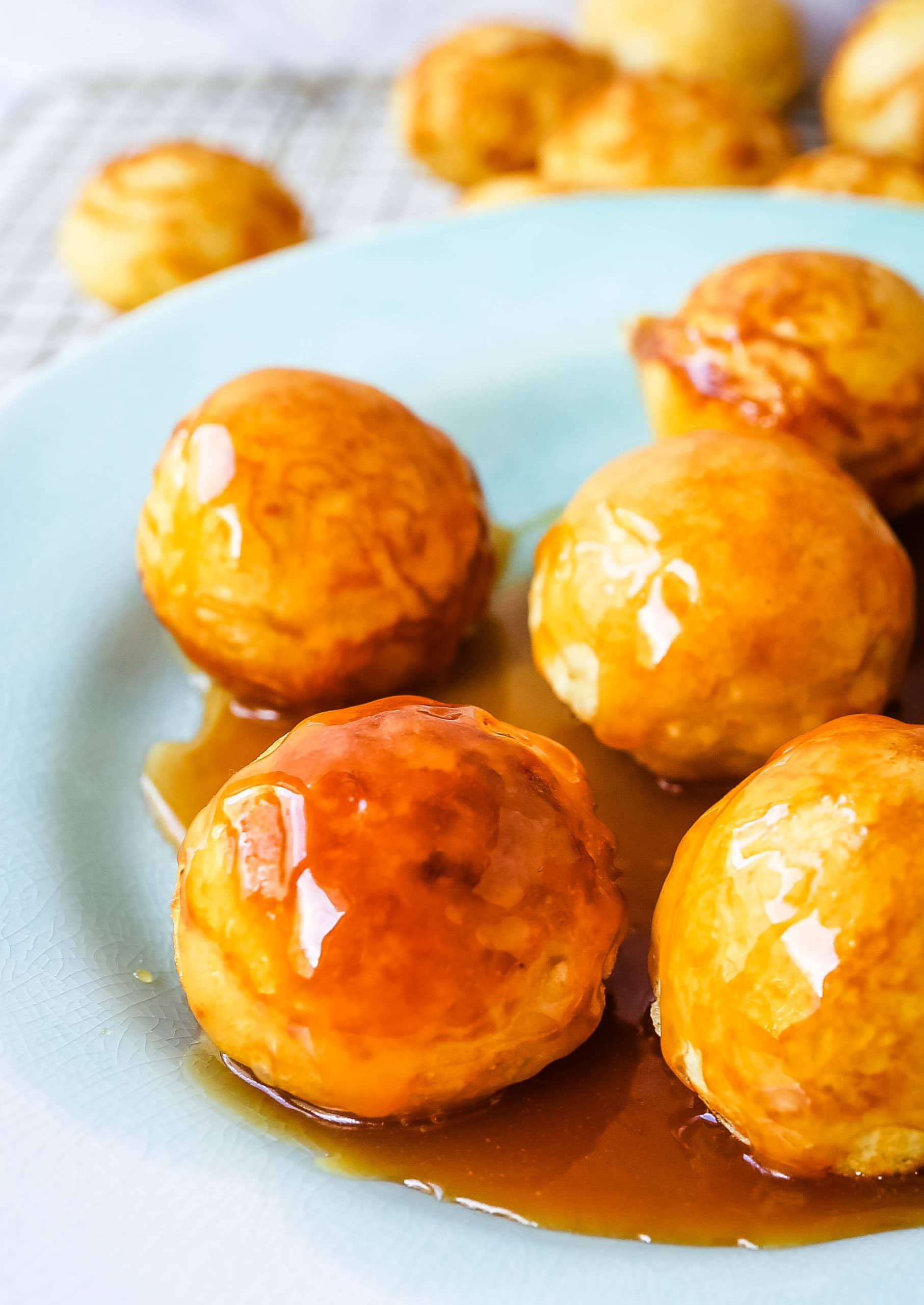 Aebleskiver Danish Pancakes a traditional Danish breakfast or dessert popular in Denmark is a circle pancake cooked in an aebleskiver pan and served with jam, powdered sugar, syrup, and fruit.  www.modernhoney.com #aebleskivers #danishpancakes #pancakes