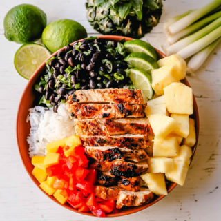 Jerk Chicken Bowl Jamaican spiced grilled Jerk Chicken with rice, black beans, cilantro, fresh pineapple and mango, and red peppers.www.modernhoney.com #jerkchicken #chicken #chickenbowl