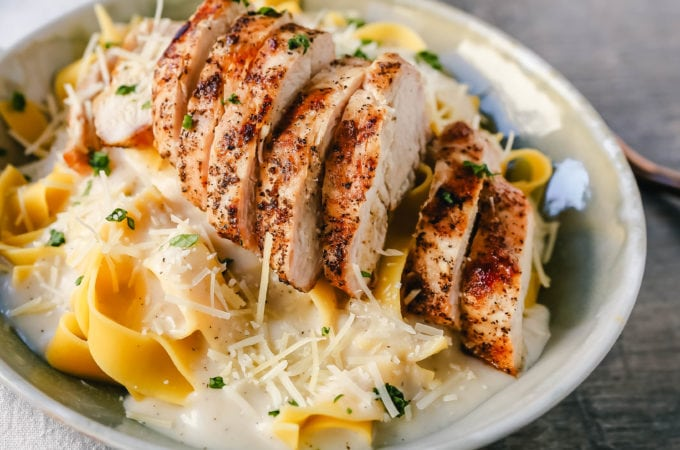 Skinny Low-Fat Chicken Fettuccine Alfredo All of the flavor of Chicken Fettuccine Alfredo without all of the fat and calories! Lean grilled chicken on top of low-fat alfredo sauce tossed with fettuccine noodles. www.modernhoney.com #lowfat #chicken #pasta