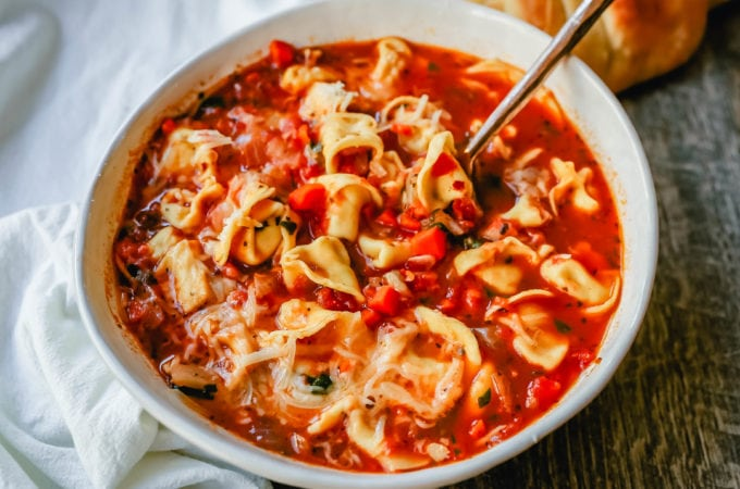 Tuscan Tortellini Vegetable Soup Robust vegetable soup with onions, garlic, carrots, tomatoes, basil, oregano, in a warm broth with creamy cheese tortellini and fresh parmesan cheese. The best tortellini soup! www.modernhoney.com #soup #tortellinisoup
