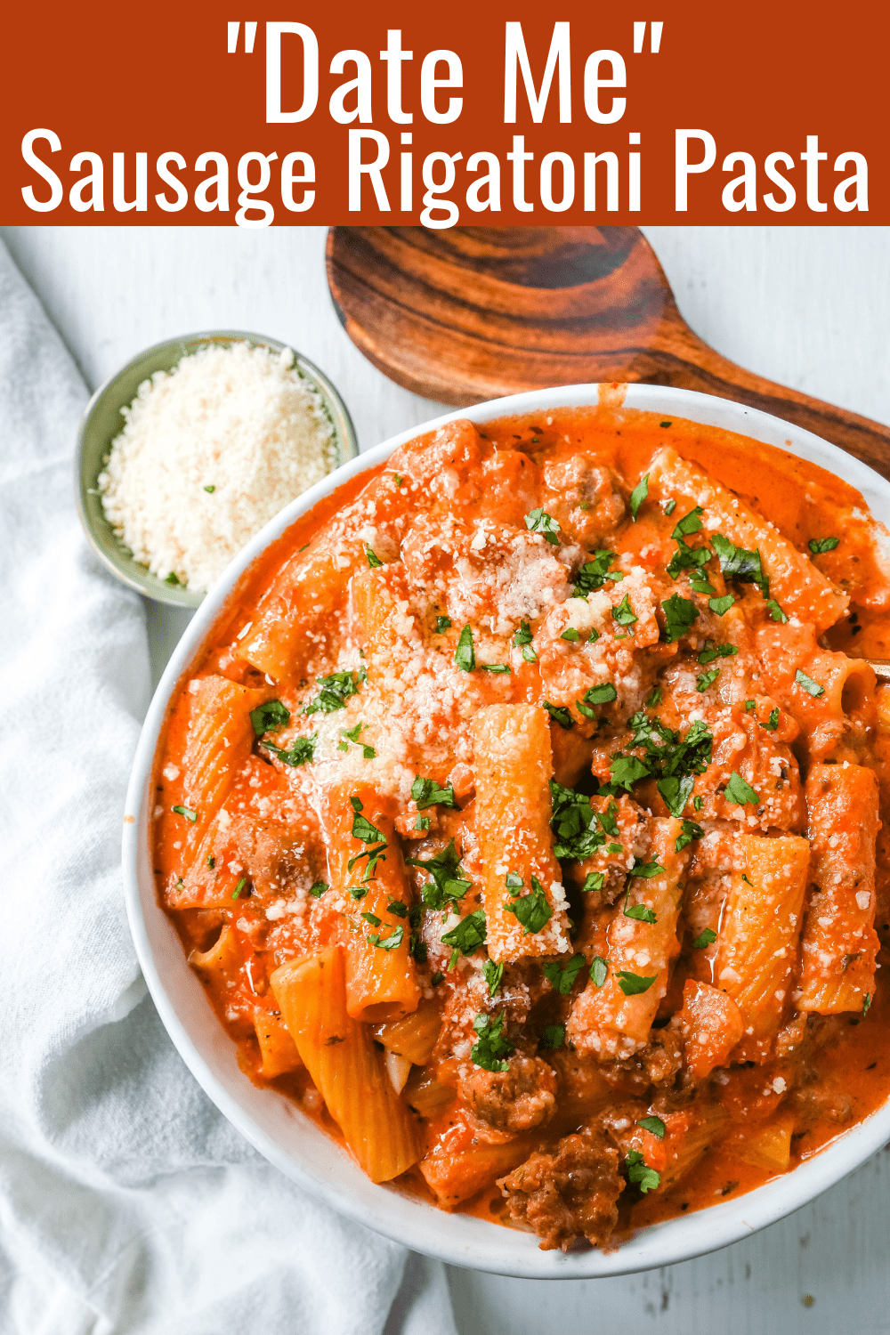 """Date Me"" Creamy Sausage Rigatoni Pasta Homemade rich and creamy tomato cream and sausage sauce tossed with rigatoni and topped with parmesan cheese. The best creamy sausage rigatoni pasta! #pasta #dinner"