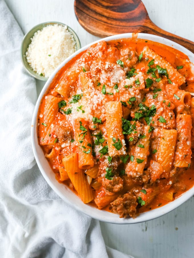 """""""Date Me"""" Creamy Sausage Rigatoni Pasta Homemade rich and creamy tomato cream and sausage sauce tossed with rigatoni and topped with parmesan cheese. The best creamy sausage rigatoni pasta! #pasta #dinner"""