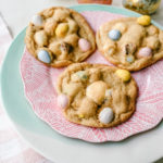 Chocolate Cadbury Egg Cookies A White Chocolate Chip and Famous Chocolate Mini Cadbury Eggs Cookie. Soft and chewy centers with crispy edges and decadent mini Cadbury eggs. A perfect Easter cookie! www.modernhoney.com #cookie #cookies #eastercookie #cadburyeggs