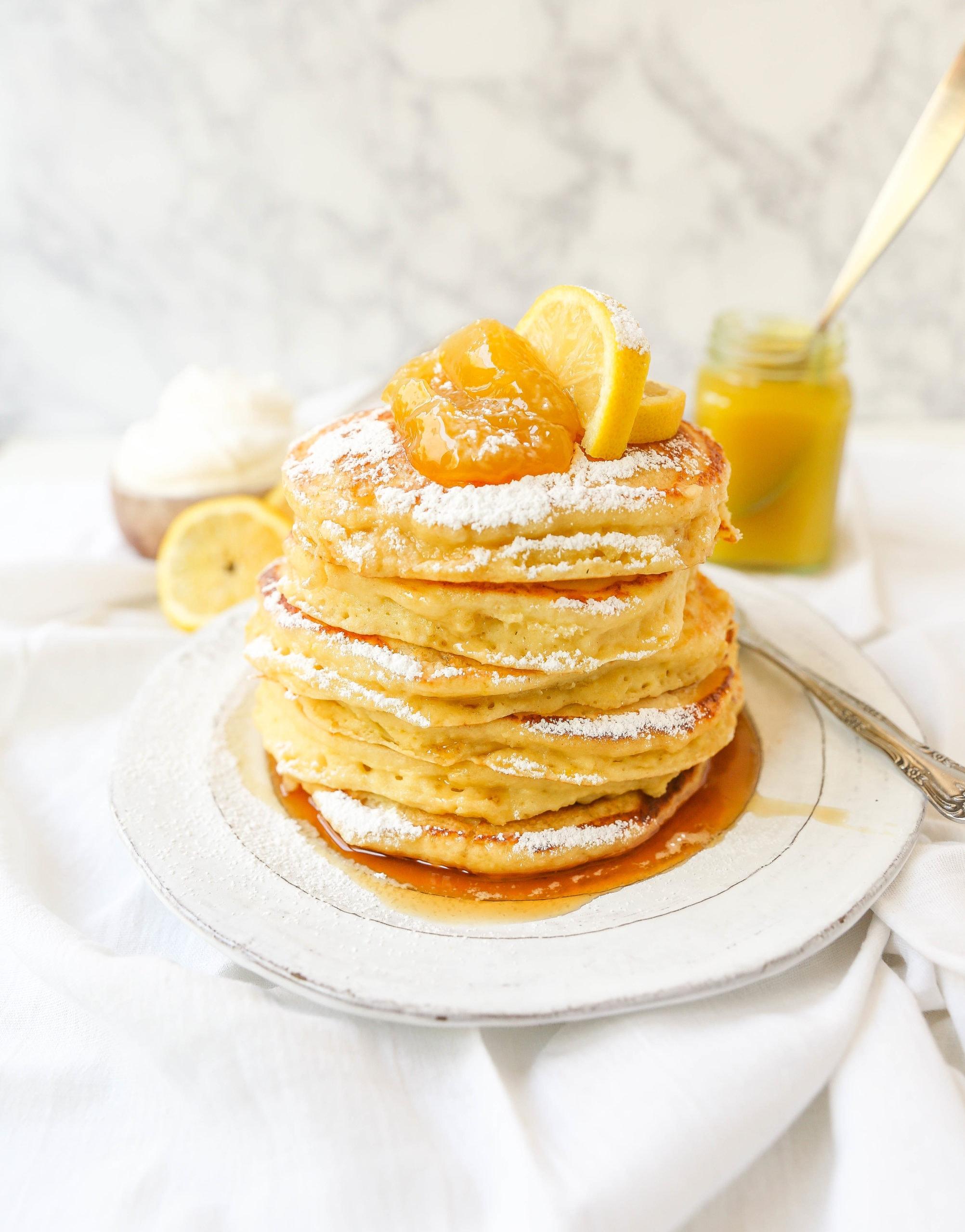 Lemon Ricotta Pancakes Creamy, fluffy lemon ricotta pancakes made with fresh ricotta, buttermilk, fresh lemon zest, and juice. A mix between a pancake and a crepe with a melt-in-your-mouth soft texture.www.modernhoney.com #pancakes #lemonricottapancakes #brunch #breakfast