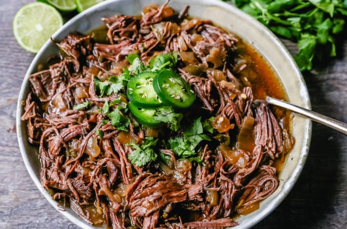 Slow Cooker Barbacoa Beef Tender, flavorful, slow-cooked beef with onions, jalapenos, and spices make this the perfect barbacoa beef for burritos, tacos, enchiladas, quesadillas, on a salad, or just on its own with a few side dishes.