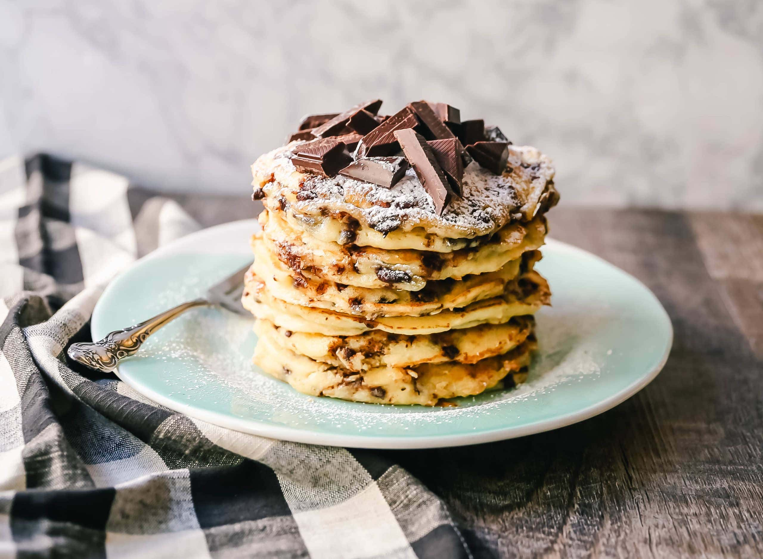 Chocolate Chip Ricotta Pancakes Creamy homemade one-bowl ricotta pancakes with chocolate chips. How to make easy 5-minute chocolate chip ricotta pancakes from scratch! www.modernhoney.com #ricottapancakes #pancakes #chocolatechipricottapancakes