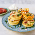 Mini Egg Bacon and Cheese Bites A quick and easy bite-size high-protein and low-carb breakfast. These mini egg bites are the perfect start for your day! www.modernhoney.com #eggbites #eggbaconbites #breakfast