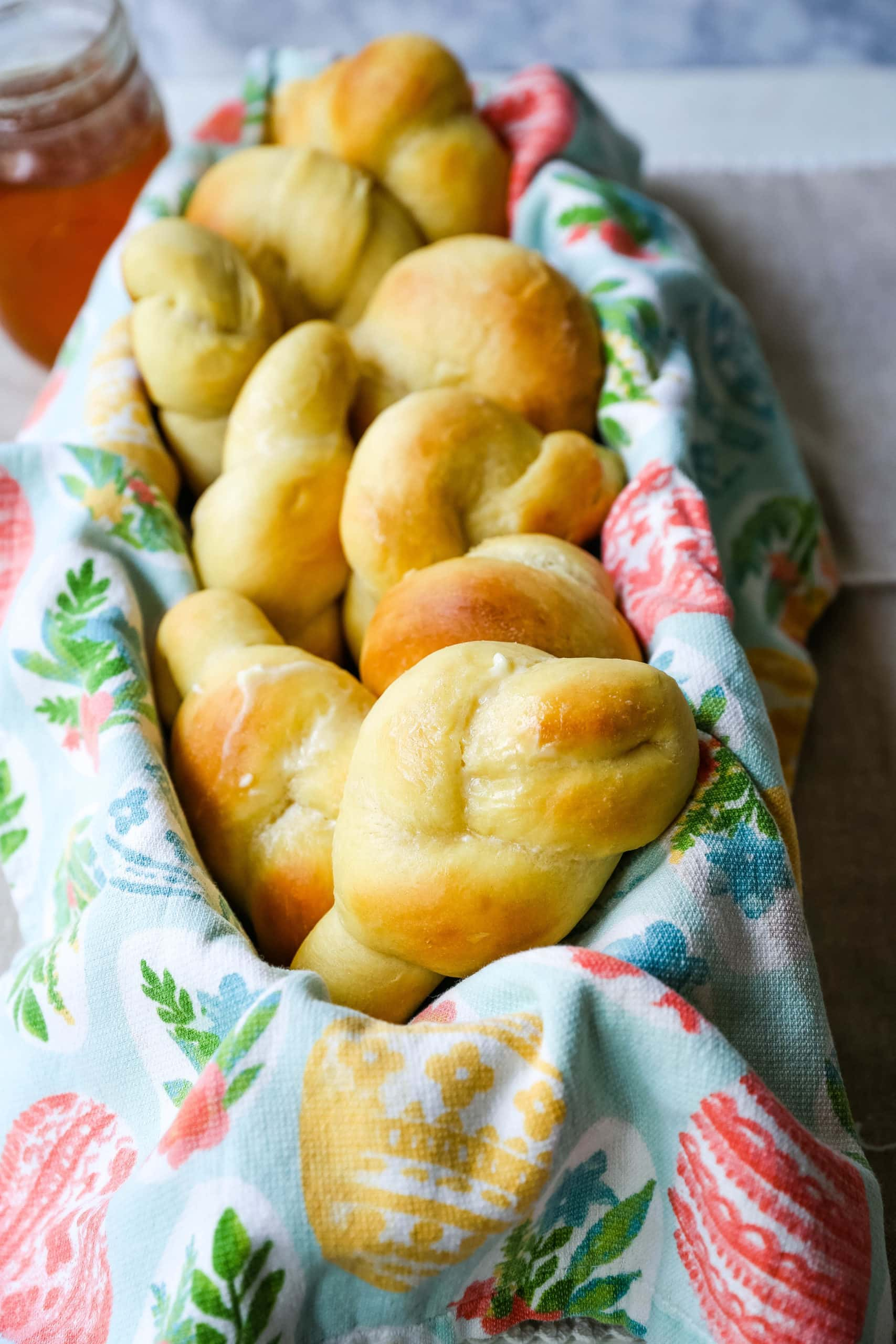Homemade Knotted Rolls Buttery, fluffy homemade rolls tied in knot and brushed with butter. The perfect knotted rolls recipe! www.modernhoney.com #rolls #easter #dinnerrolls #knottedrolls