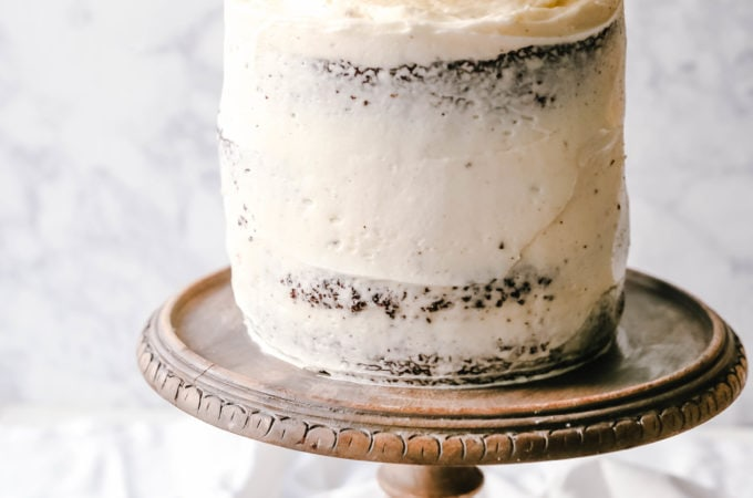 Black and White Cake -- Chocolate Cake with Vanilla Frosting Rich, moist homemade chocolate cake with a creamy vanilla bean frosting with a touch of cream cheese. The perfect Black and White Cake!