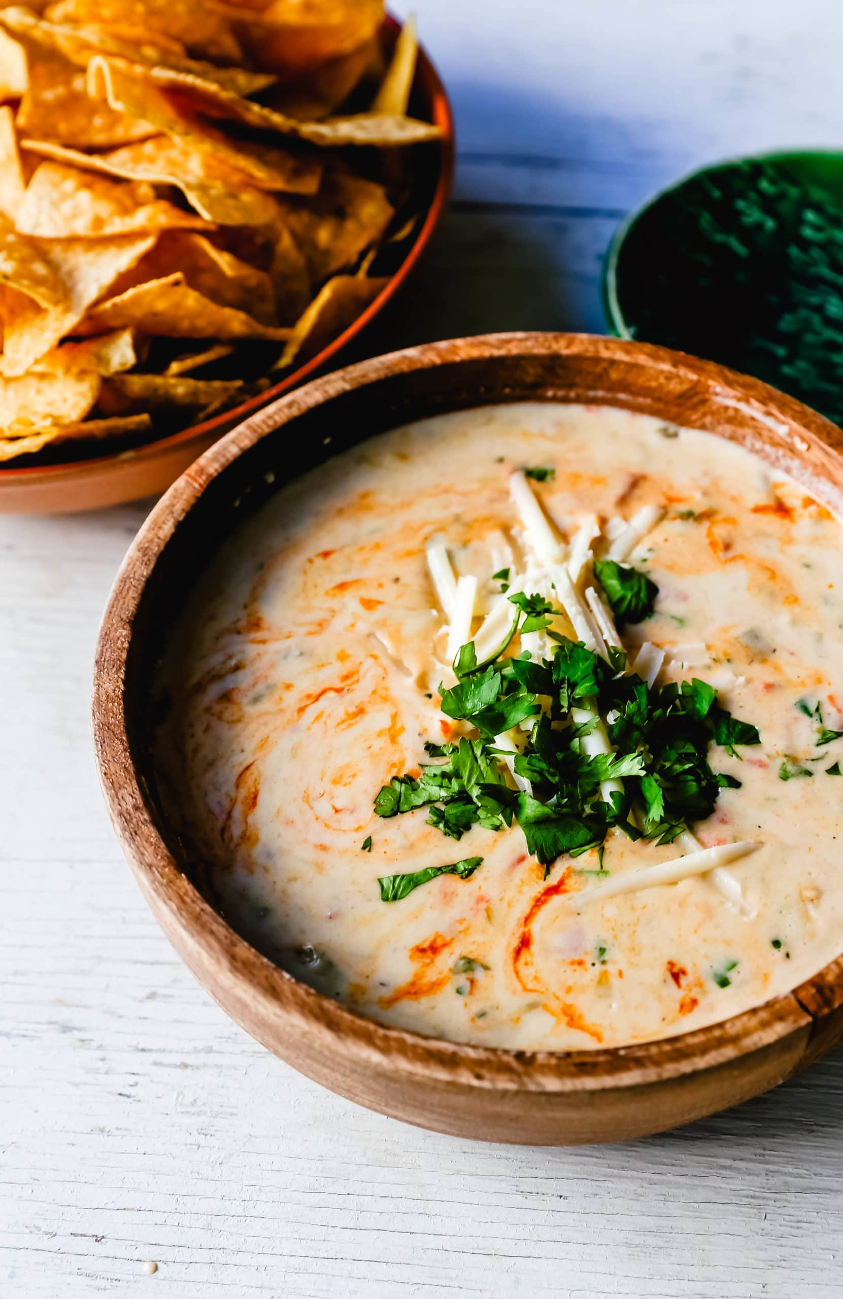 Queso Dip Creamy green chile queso blanco dip made with the perfect blend of cheeses, green chiles, fresh cilantro, and hot sauce. How to make the perfect homemade queso! #queso #cincodemayo #mexican #mexicanfood