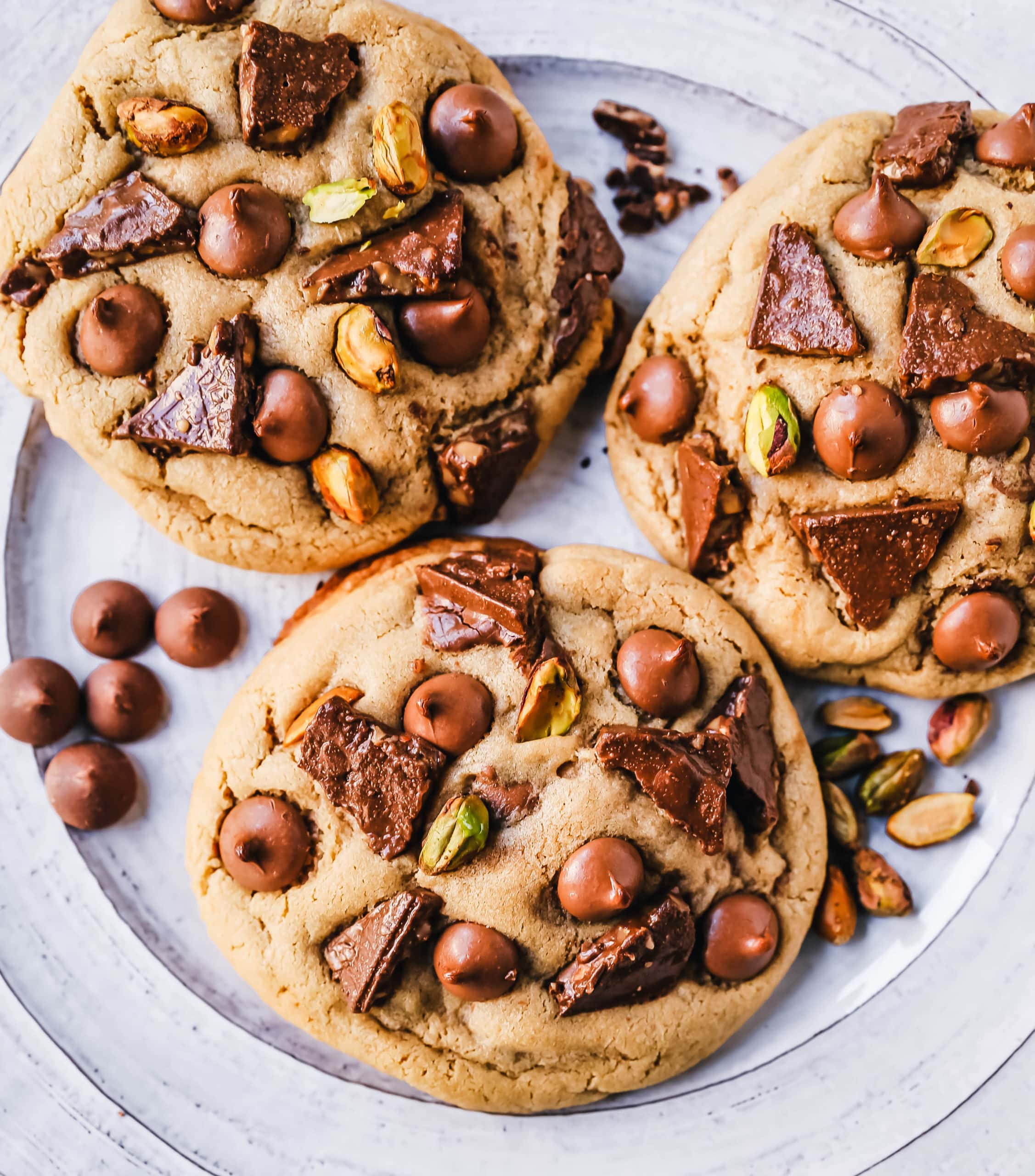 Pistachio Toffee Chocolate Chip Cookies Thick, chewy bakery-style cookies with milk chocolate toffee, pistachios, and milk chocolate chips. A sweet and salty cookie!