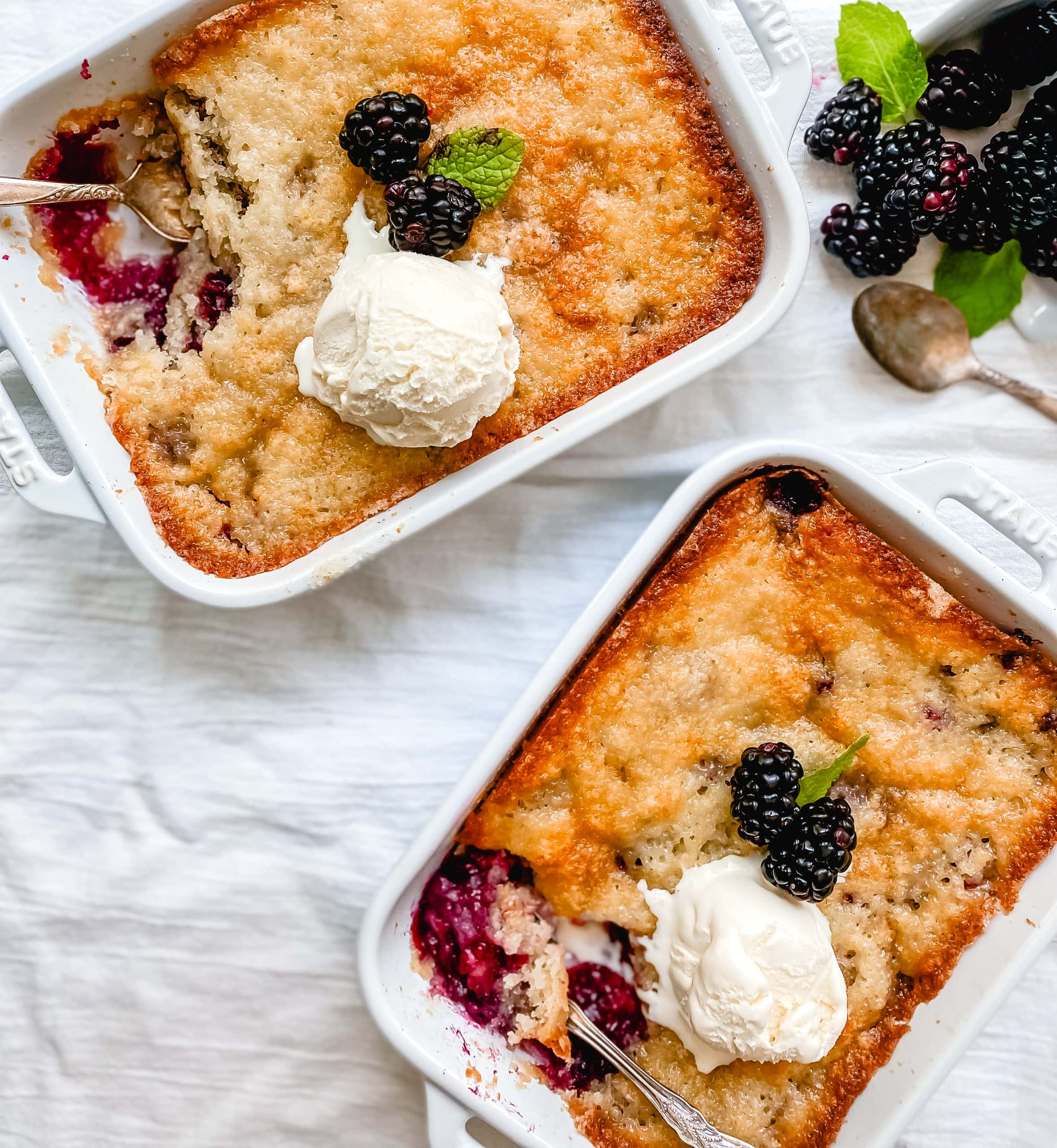 Blackberry Cobbler. A Texas favorite! This Blackberry Cobbler is made with a sweet, buttery crust with fresh sweetened blackberries and topped with vanilla bean ice cream. The perfect summer dessert recipe!