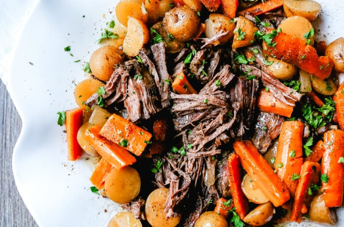Beef Pot Roast Tender, slow-cooked, flavorful beef pot roast with golden potatoes and savory carrots. How to make the most flavorful, moist, and tender pot roast at home.
